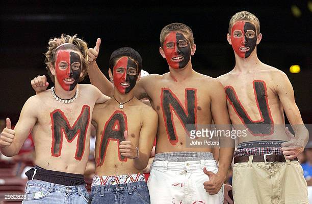 Four male American fans show their support for United by painting Man U on their bare chests during the friendly match between Manchester United v...