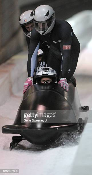 Four man bobsled team of Cory Butner, Chuck Berkeley, Andreas Drbal and Chris Langton cross the finish line in third after the second of their...