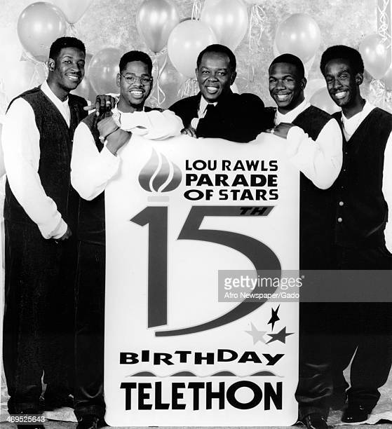 A four man singing group Boyz II Men specialists in RB soul and acapella music posing with a large fund raising placard during a telethon Lou Rawl's...