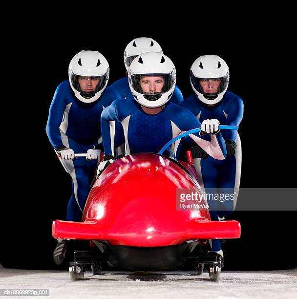 Four man team launching bob-sleigh