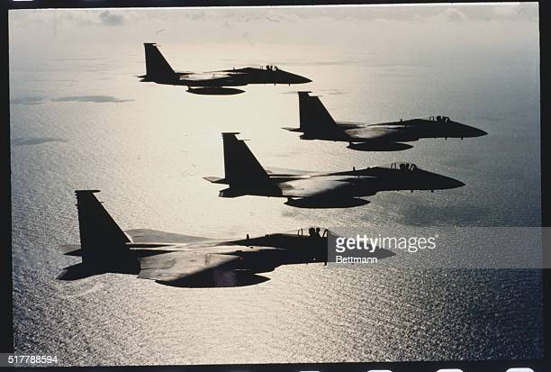 Four McDonnell Douglas F15 Eagle fighters over the Gulf of Mexico
