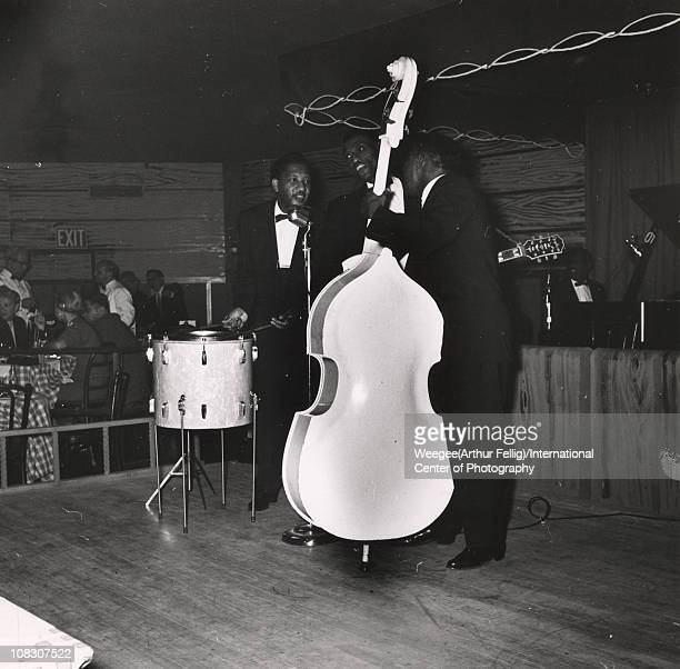 Four members of a jazz or blues band perform on stage with drums guitar bass and piano perhaps at the Basin Street night club New York ca 1950s Photo...