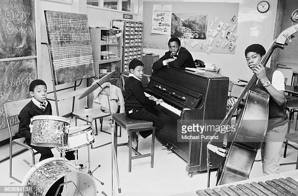 Four members of British reggae group Musical Youth in a music room at their school Duddeston Manor School Birmingham UK 1982 Left to right guitarist...