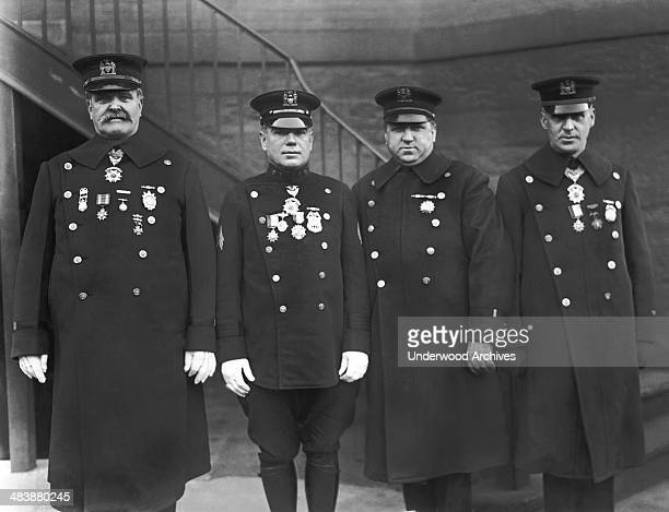 Four members of the New York City police department's Honor Legion New York New York mid to late 1920s All have medals for bravery