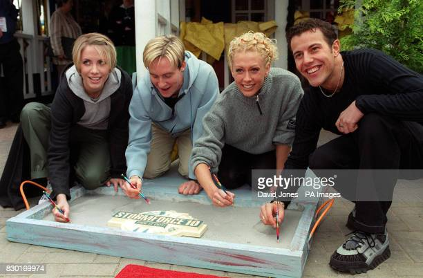 Four members of the Pop group Steps Claire 'H' Faye and Lee sign their names after leaving their footprints in concrete to mark the launch of the new...
