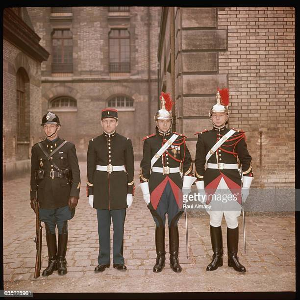 Four members of the Republican Guard model the various Guard uniforms in the courtyard of the Elysee Palace Paris France