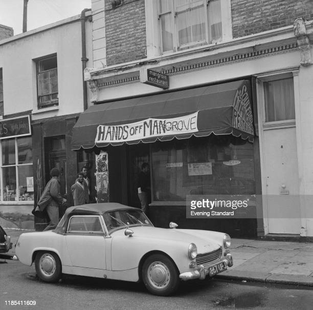 Four men entering the Mangrove a Caribbean restaurant on All Saints Road Notting Hill London 10th August 1970 The restaurant seen here with a banner...