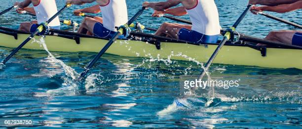 four men in a rowboat - team sport stock pictures, royalty-free photos & images