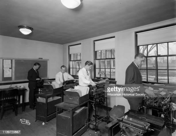 Four men in bookkeeping department at the Security State Bank, 1965 Atwood Avenue, Madison, Wisconsin, March 25, 1927. They are standing and working...