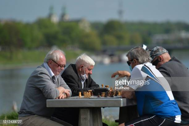 Four men play chess near Wawel Castel in Krakow. Since Monday May 4th, the second stage of defrosting the Polish economy and loosening of...