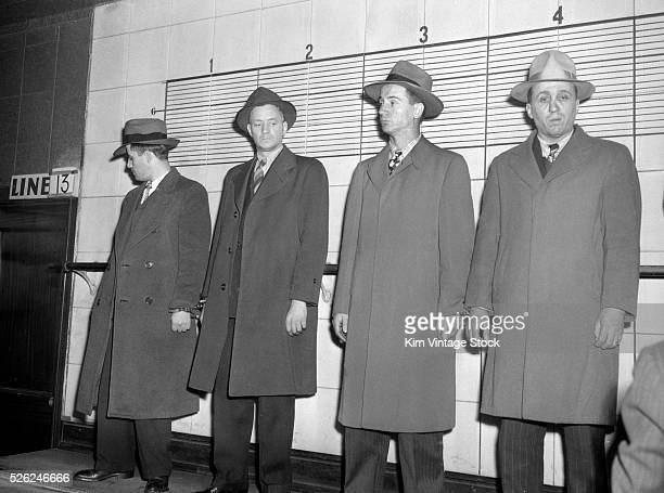 Four men stand in a police lineup for a witness to look over