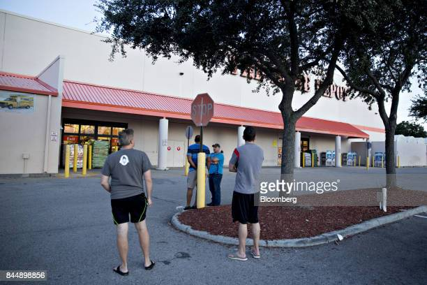 Four men stand outside a Home Depot Inc store after finding it closed ahead of Hurricane Irma in Tampa Florida US on Saturday Sept 9 2017...