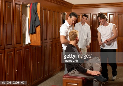 Four Men Talking In Locker Room Laughing One Dressing