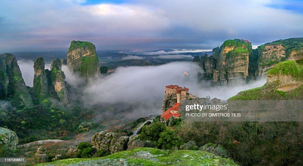 Four Meteora monasteries in mist panorama 2 : Stock Photo