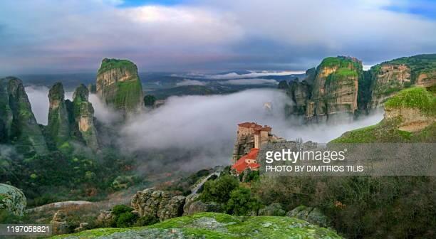 four meteora monasteries in mist panorama 2 - dimitrios tilis stock pictures, royalty-free photos & images