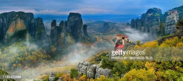Four Meteora monasteries in mist panorama 3