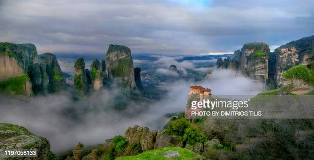 four meteora monasteries in mist panorama 4 - thessaly stock pictures, royalty-free photos & images