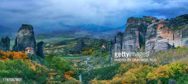 four meteora monasteries panorama - dimitrios tilis stock pictures, royalty-free photos & images