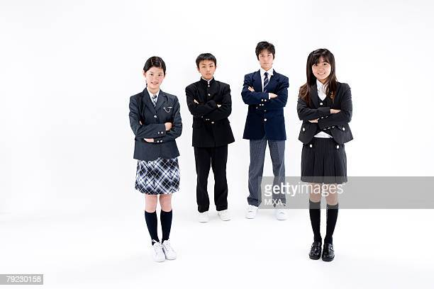 four middle school students standing - 14歳から15歳 ストックフォトと画像