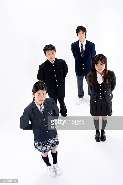 Four middle school students standing