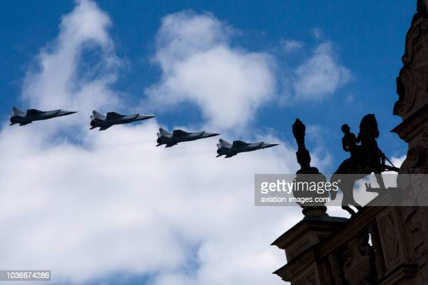 Four Mikoyan MiG31military airplanes fly in formation over Moscow during a rehearsal for the Victory Day military parade to celebrate the 71st...