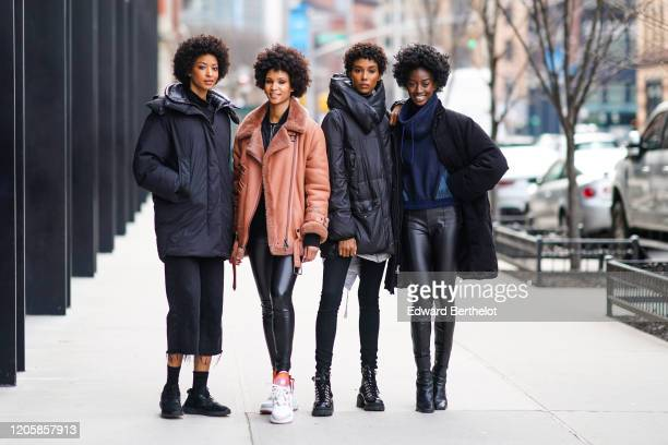 Four models are posing, during New York Fashion Week Fall Winter 2020, on February 12, 2020 in New York City.