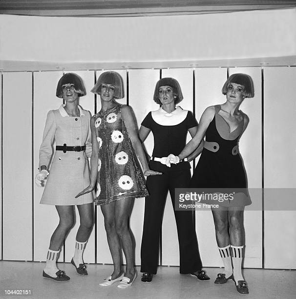 Four models of fashion designer COURREGES'S PRESENTATION DANSEE being shown In the center two evening outfits are being shown