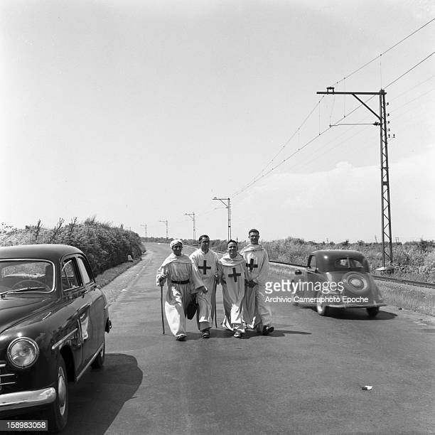 Four monks walk along a country road Rome Italy 1955