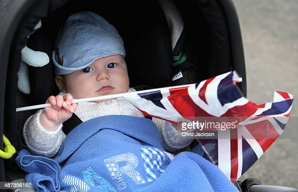 Four month old Harry Pettie waves his Union Jack as he waits for Queen Elizabeth II and Prince Philip Duke of Edinburgh to arrive at Tweedbank...