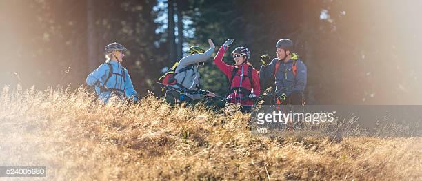Four mountain bikers taking a break on a meadow
