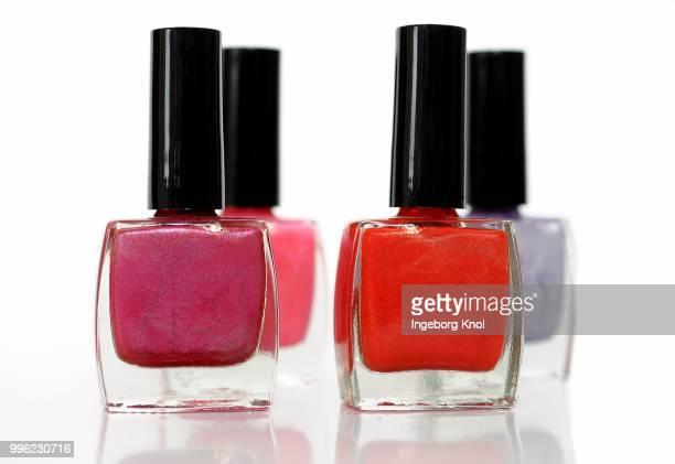 Four nail polish bottles, different colors