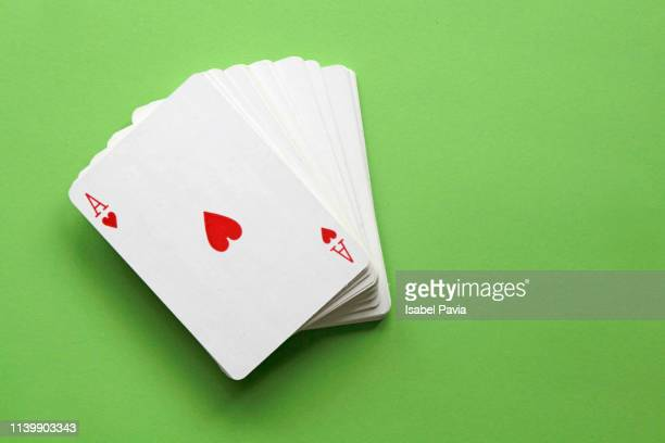 four of kind aces poker hand. - kaart stockfoto's en -beelden