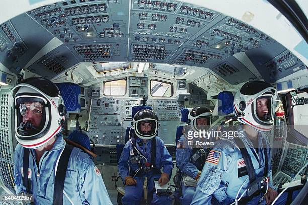 Four of the astronauts selected for the Space Shuttle Challenger mission in 1986 sit in the shuttle mission simulator From left they are Michael J...