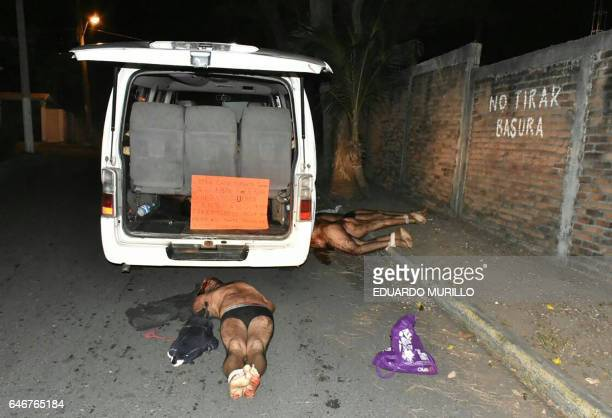 Four of the eleven corpses of men and women found dead in a van hands and legs tied remain at the crime scene in Graciano Sanchez neighbourhood in...