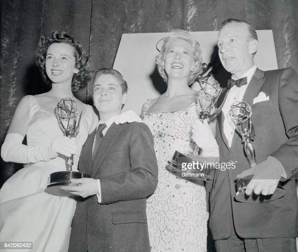 Four of the 'Emmy' Award winners from the West Coast Proudly show their trophies they won for the Best Childen's Series show Lassie Singer Dinah...