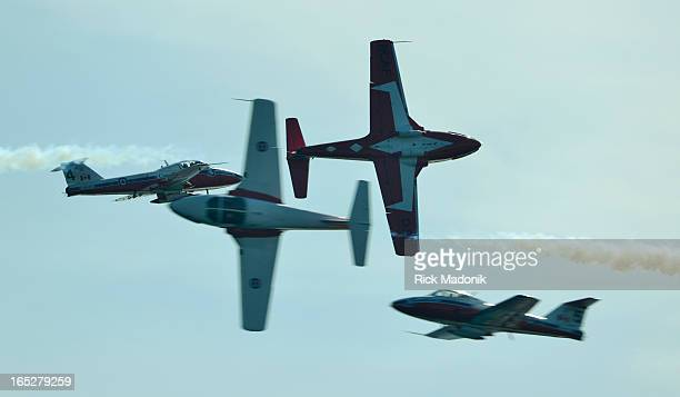 120901 TORONTO ONTARIO Four of the famed Canadian Snowbirds pass each other in opposing directions two headed east two headed west The 63rd annual...