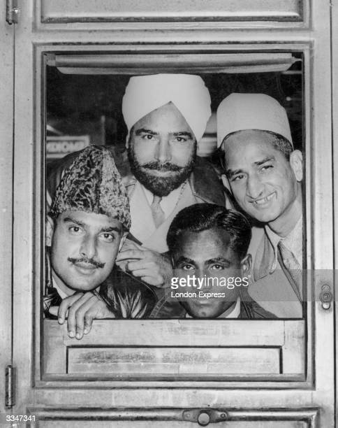 Four of the Indian Hockey team including legend Dhyan Chand that won the Olympic Gold Medal at Berlin peering out of a train window at Liverpool...