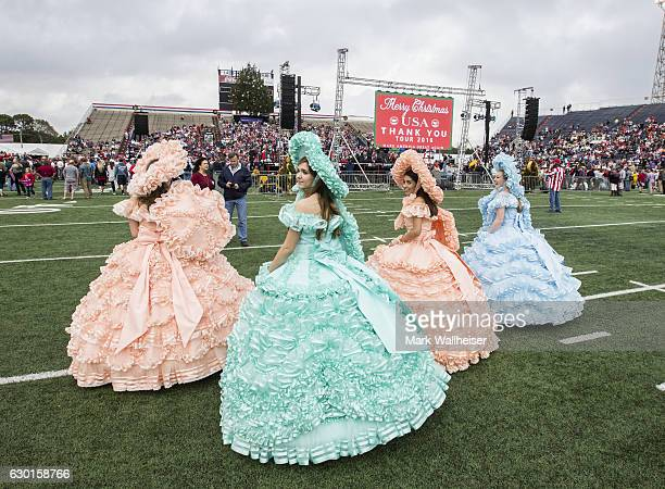 Four of the Mobile Azalea Trail Maids walk the field at presidentelect Donald Trump thank you rally in LaddPeebles Stadium on December 17 2016 in...