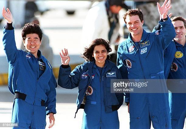 Four of the US space shuttle Columbia's six international crewmembers 05 December Japanese Takao Doi Indian born Kalpana Chawla US Commander Kevin...