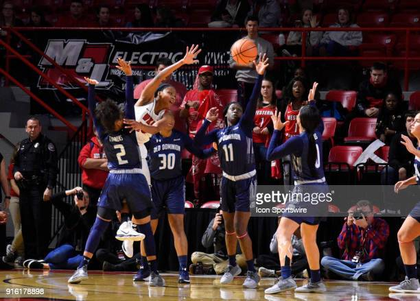 Four Old Dominion Lady Monarchs defenders try to block the shot of Western Kentucky Lady Toppers forward Tashia Brown during the third period of the...