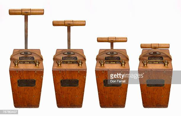 four old fashioned wooden blasting detonators, studio shot - detonator stock photos and pictures