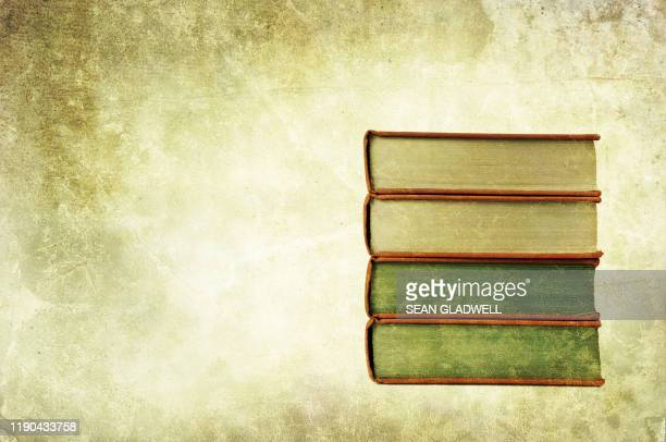 four old stacked books - history stock pictures, royalty-free photos & images