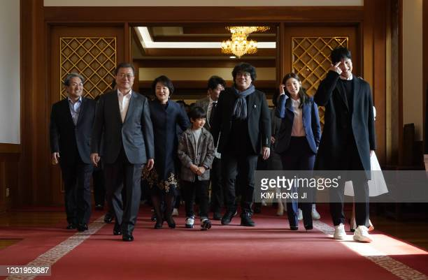 Four Oscar awardwinning film 'Parasite' director Bong Joonho and South Korean President Moon Jaein walk for a luncheon at the Presidential Blue House...