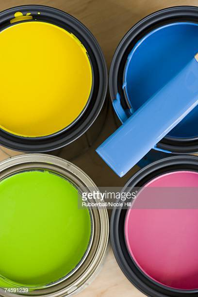 Four paint cans and stir stick from above
