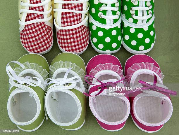 Four pair of baby shoes.