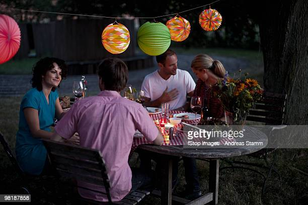 Four people at a dinner party