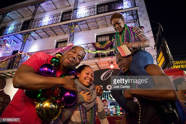four people celebrating mardi gras in new orleans - mardi gras fun in new orleans stock photos and pictures