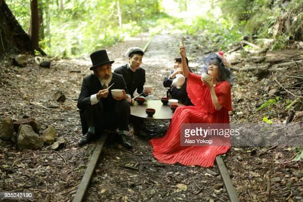 four people having breakfast