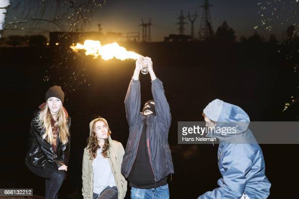 Four people having fun with fire