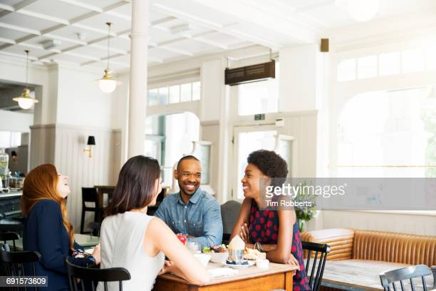 Four people having lunch